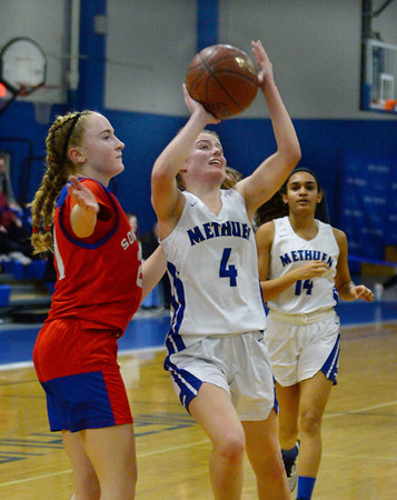 CARL RUSSO/Staff photo Methuen Bella Keaney fights her way to the basket. Methuen defeated Somerville 61-47 in girls' basketball action Tuesday night. 2/18/2020.