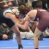 TIM JEAN/Staff photo <br /> <br /> St. John's Prep Nick Curley, left, takes on Chelmsford's Evan Kinney in the 113 pound final during the MIAA Division 1 wrestling finals at Methuen High School.    2/22/20