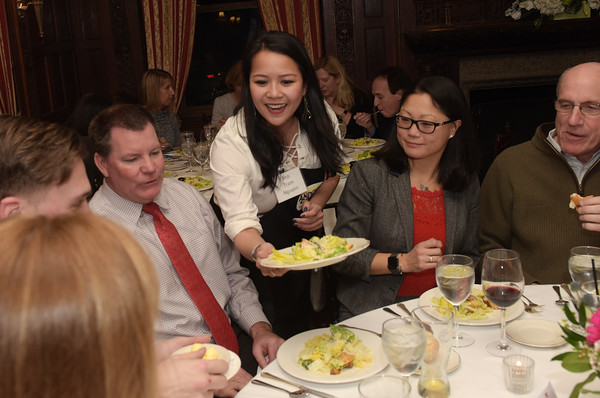 TIM JEAN/Staff photo <br /> <br /> State Rep. Tram Nguyen serves dinner as a Superstar Server and during the Andover Cares fundraiser at the LANAM club in Andover. 2/27/20