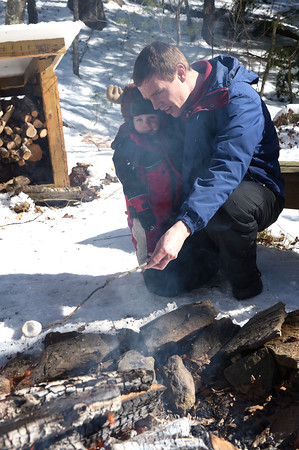 TIM JEAN/Staff photo <br /> <br /> Steve Bell, of Londonderry, roast a marshmallow with his son Kenneth, 2,  near the fire pit during the Annual Musquash Field Day in Londonderry, NH.  2/15/20