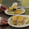 TIM JEAN/Staff photo <br /> <br /> Sandwiches like these French Ham and Brie, made with Black Forest Ham, double cream brie, fresh apple slices and dijon mustard and the Classic French Dip made with Sliced Roast Beef on a baguette with arugula horseradish cream and au jus made for an customer in the student-run Beacon Cafe at North Shore Community College's Middleton campus.    1/30/20