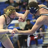 TIM JEAN/Staff photo <br /> <br /> Haverhill's Steven Wise, left, takes on Framingham's Nick Crotty in the 152 pound match during the MIAA Division 1 wrestling finals at Methuen High School.    2/22/20