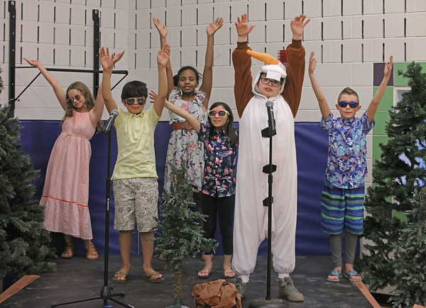 """MIKE SPRINGER/Staff photo<br /> The snowman """"Olaf,"""" played by fifth-grader Aidan Vadala-Mitchell, second from right, performs with the """"Summer Chorus"""" during a scene in the children's version of the Disney musical """"Frozen"""" on Thursday at Soule Elementary School in Salem. From left are Kaylee McSheehy, Kevin Ramos, Thalia Emilien, Alayna McNamara, Aidan, and Christopher Rozumek.<br /> 2/20/2020"""
