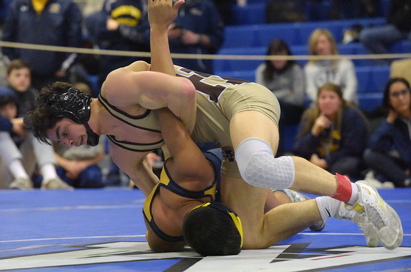 TIM JEAN/Staff photo <br /> <br /> Haverhill's, Jake Nicolosi, top, wrestlers against Andover's Jonathan Davoll during the 145 pound final in the MIAA Division 1 North sectional at Methuen High School.   2/15/20