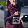 TIM JEAN/Staff photo <br /> <br /> <br /> Brittney Webber, of Atkinson, NH., was the first female to finish the annual Bradford Valentine Road Race. Finishers received a small box of chocolates, commemorative medal, and a Valentines flower.  2/8/20