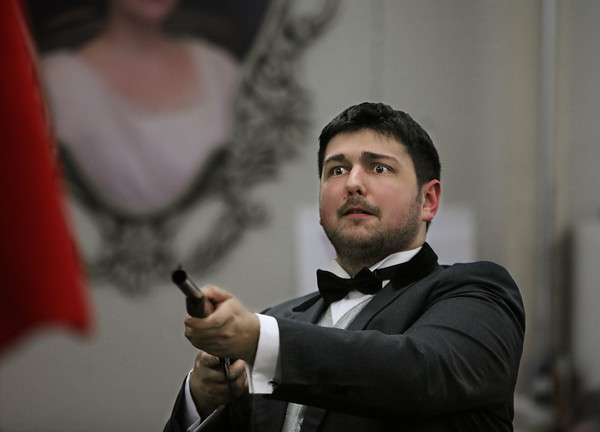 "MIKE SPRINGER/Staff photo<br /> Conor Meehan of Andover rehearses a scene in the Spotlight Playhouse's production of ""A Gentleman's Guide to Love and Murder.""<br /> 2/25/2020"
