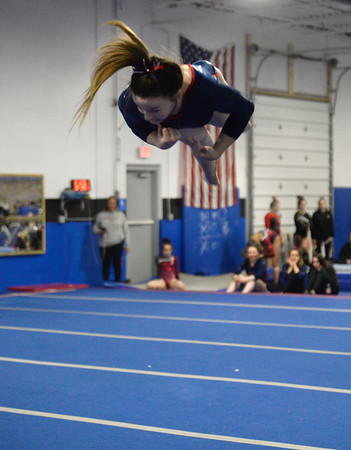 CARL RUSSO/Staff photo Central Catholic sophomore,  Deidre Donovan somersaults across the floor during the floor routine. <br /> <br /> The Merrimack Valley Conference Gymnastic League Meet was held Thursday night, February 6, at A2 Gym and Cheer in Salem NH. 2/6/20200.
