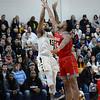 CARL RUSSO/Staff photo. Merrimack's Idris Joyner takes the jump shot over Sacred Heart's E. J. Anosike. Merrimack College defeated Sacred Heart 64-57 in men's basketball action. 2/21/2020