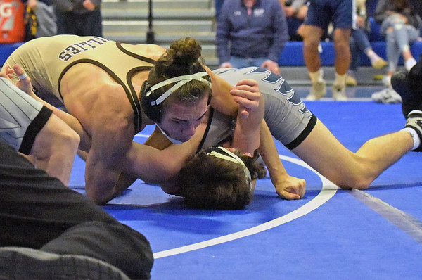 TIM JEAN/Staff photo <br /> <br /> Haverhill's Edgar Feliciano, top, pins St. John's Prep Quinn Alexander during the 132 pound final in the MIAA Division 1 North sectional wrestling at Methuen High School.   2/15/20