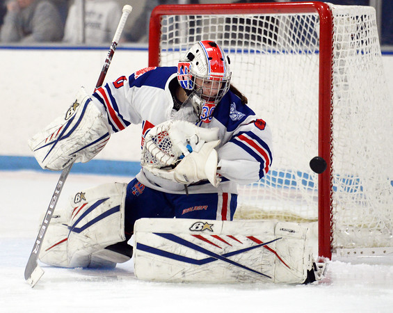 CARL RUSSO/Staff Photo Methuen/Tewksbury's goalie, Kaia Hollingsworth keeps her eye on the puck after making the save in the second period. Methuen/Tewksbury defeated Longmeadow in OT 2-1 girls hockey tournament opener. 2/26/2020.
