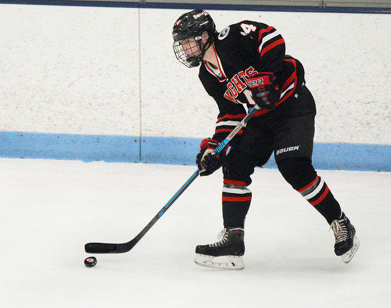 CARL RUSSO/Staff photo North Andover's Jimmy Boyle keeps the puck moving. He scored the third goal for the Knights in the third period. <br /> <br /> North Andover defeated Tewksbury 3-2 in Div. 2 hockey quarterfinals at the Chelmsford Forum Friday night. 2/28/2020