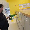 TIM JEAN/Staff photo <br /> <br /> Custodian Eric Russell, demonstrates how the germ blaster sprays a fine mist to disinfect surfaces on the lockers at the Hunking School in Haverhill.      2/14/20