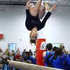 CARL RUSSO/Staff photo Central Catholic's senior captain, Meagan Kelly somersaults as she competes on the beam.<br /> <br /> The Merrimack Valley Conference Gymnastic League Meet was held Thursday night, February 6, at A2 Gym and Cheer in Salem NH. 2/6/2020. 0.