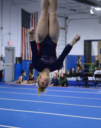 CARL RUSSO/Staff photo Central Catholic's senior captain, Meagan Kelly flips head over heals as she competes in the floor routine. <br /> <br /> The Merrimack Valley Conference Gymnastic League Meet was held Thursday night, February 6, at A2 Gym and Cheer in Salem NH. 2/6/2020.