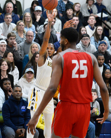 CARL RUSSO/Staff photo. Merrimack's Juvaris Hayes takes the three point jump shot in front of the sold out crowd. Merrimack College defeated Sacred Heart 64-57 in men's basketball action. 2/21/202. .