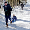 TIM JEAN/Staff photo <br /> <br /> Kid Considine, of Goffstown, pulls his daughter Genevieve, 5, in a sled along the Landing Trail during the Annual Musquash Field Day in Londonderry, NH.  2/15/20