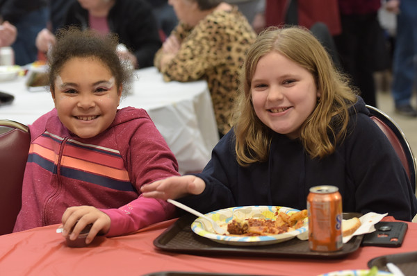 TIM JEAN/Staff photo <br /> <br /> Best friends Macee Brown, 8, left, and Ava McCarthy, 10, both of Haverhill enjoys dinner during the Haverhill Sons of Italy pasta dinner in the basement of All Saints Church. The dinner featured salad, pasta, bread, and meatballs made by Larry Gaiero, the winner of last year's meatball cooking contest.    2/22/20