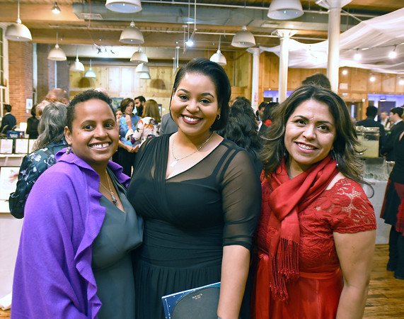 RYAN HUTTON/ Staff photo<br /> From left, Maria Medina, Jennifer Mezquila and Marisol Reyes from Northern Essex Community College at the GLOW Gala at Everett Mill in Lawrence on Thursday night November 14 marking the 20th anniversary of Groundwork Lawrence. 11/14/2019