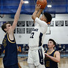 CARL RUSSO/Staff Photo. Lawrence's captain Noah Tejada makes the lay up from the corner against Andover's captain, Charlie McCarthy, right and Aidan Cammann. Lawrence defeated Andover 60-54 in boys Basketball action in the D1 North tournament. 2/25/2020