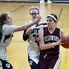CARL RUSSO/Staff photo PMA's Shannon Colleyer, left and Grace Boyle double team to cover Fellowship's Ester Mills. Presentation of Mary Academy defeated Felllowship Christian Academy 51-43 in girls' basketball action Tuesday afternoon. 2/04/2020