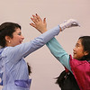 "MIKE SPRINGER/Staff photo<br /> Fifth-grader Chanelle Mazraany, left, plays ""Elsa"" and Ryeanne Delim, a fourth-grader, plays ""Anna"" in the children's version of the Disney musical ""Frozen"" on Thursday at Soule Elementary School in Salem. The play was directed by Rebecca Pacuk and featured more than 40 students from the 4th and 5th grades.<br /> 2/20/2020"