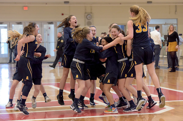 TIM JEAN/Staff photo <br /> <br /> Andover girls basketball team celebrates defeating Central Catholic 63-55 during the Division 1 North quarterfinals at Central. 2/29/20
