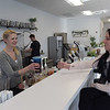 TIM JEAN/Staff photo <br /> <br /> Nutrition Corner owner Kelsey Macomber hands a Mermaid Water to Kristen Calamari, 23, of Windham. The Juice and Smoothie bar is on the corner Route 111 and Island Pond Road in Derry.     1/31/20
