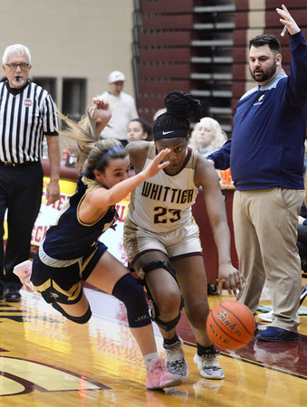 CARL RUSSO/Staff Photo Whittier's Grace Efosa-Aguebor is called on a blocking foul knocking Winthrop's Maddie Stiglets to the floor. Winthrop defeated Whittier Tech. 55-39 in Div. 3 North quarterfinals in girls basketball action Thursday night. 2/27/2020