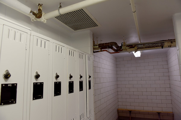 TIM JEAN/Staff photo <br /> <br /> Exposed heating pipes seen above in the small boys locker rooms located downstairs below the gymnasium. Students gave tours to parents and future students during a tiles and tours night at Pelham Memorial School, organized by Pelham ACES. Voters will be asked to pay for renovations at Town Meeting Day on March 10th.     2/12/20