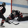 CARL RUSSO/Staff photo North Andover's goalie, Patrick Green makes the stick save. North Andover defeated Tewksbury 3-2 in Div. 2 hockey quarterfinals at the Chelmsford Forum Friday night. 2/28/2020