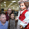 CARL RUSSO/Staff photo From left, Wayne Stanuchenski of North Andover, Philip Goddard and his wife Frances Cheney of Wakefield look at a Lithuanian doll on display. <br /> <br /> The Lithuanian American Council and The Knights of Lithuania, Council 78 celebrated its annual Independence celebration on Sunday, February 16. The celebration began with a mass at Corpus Christi Parish at Holy Rosary Church in Lawrence followed by a Lithuanian sausage dinner and entertainment at the parish center.2/16/2020