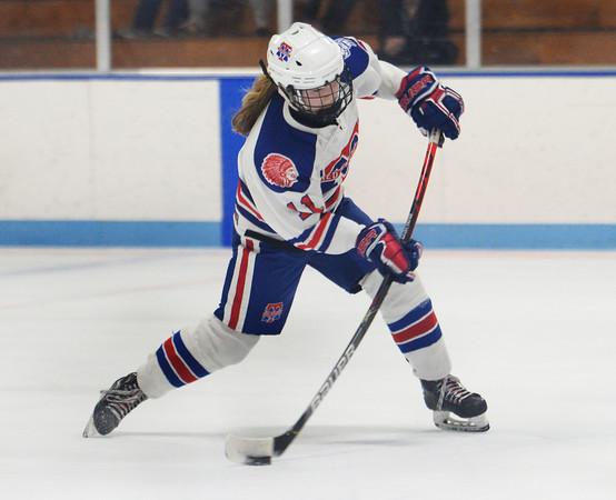 CARL RUSSO/Staff Photo Methuen/Tewksbury's Jessica Driscoll shoots on net. She scored the winning goal in OT. Methuen/Tewksbury defeated Longmeadow in OT 2-1 girls hockey tournament opener. 2/26/2020.