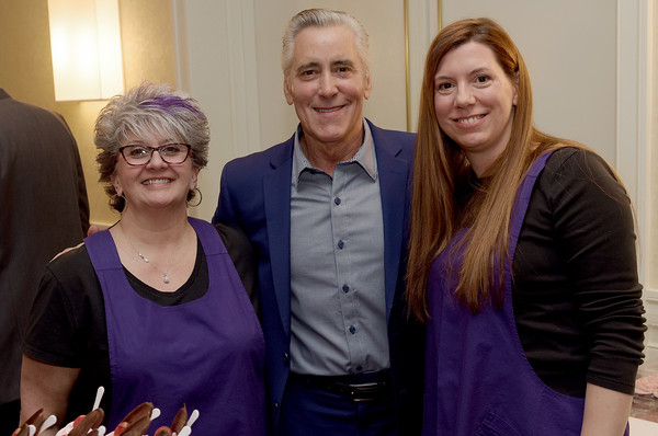 """TIM JEAN/Staff photo <br /> <br /> Host Billy Costa, center, from KISS108FM and """"Dining Playbook"""" TV fame, poses for a photo with Jacky Levine, left, owner of It's All Good... In The Kitchen, of Salem, NH., and Erin Morecroft, during Congregation Beth Israel of Andover's annual Evening of Sweet Indulgence. The event featured some of the best desserts and appetizers from the Merrimack Valley's premiere restaurants and caterers. The was also live entertainment, raffles, and auction items. It was held in the in the Grand Ballroom at the DoubleTree by Hilton in Andover.       2/1/20"""