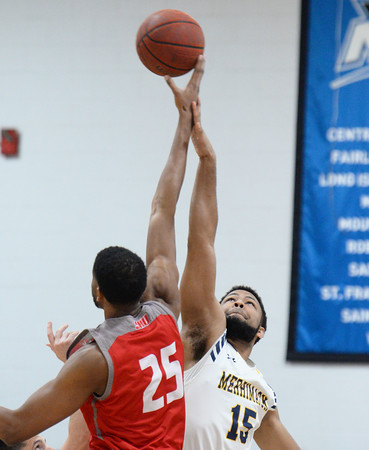 CARL RUSSO/Staff photo. Merrimack's Idris Joyner jumps ball against Sacred Heart's Jare'l Spellman to start the game. Merrimack College defeated Sacred Heart 64-57 in men's basketball action. 2/21/2020