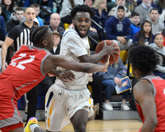 CARL RUSSO/Staff photo. Merrimack's Jaleel Lord fights his way to the basket against Sacred Heart's Tyle Thomas. Merrimack College defeated Sacred Heart 64-57 in men's basketball action. 2/21/2020