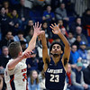 CARL RUSSO/Staff photo Central's captain, Anthony Traficante is unable stop Lawrence captain, Gabriel Zorrilla's jump shot. Central Catholic played against Lawrence in boys basketball action Tuesday night. 2/11/2020.