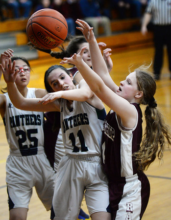 CARL RUSSO/Staff photo Fellowship's Merrie Black, right, battles for the rebound with PMA's Connie Chong, 25 and Eva Fabino. Presentation of Mary Academy defeated Fellowship Christian Academy 51-43 in girls' basketball action Tuesday afternoon. 2/04/2020