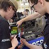 TIM JEAN/Staff photo <br /> <br /> Londonderry's Artie Adams, 15, left, and Luc Velie, 21, make an adjustment on the teams robot in the pit area during the FIRST Robotics New England Granite State District event held at Salem High School.   2/29/20