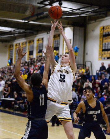 CARL RUSSO/Staff photo Andover's Aidan Cammann shoots over Lawrence captain, Brandon Goris. Andover defeated Lawrence 66-57 in boys basketball action Friday night. 2/14/2020..