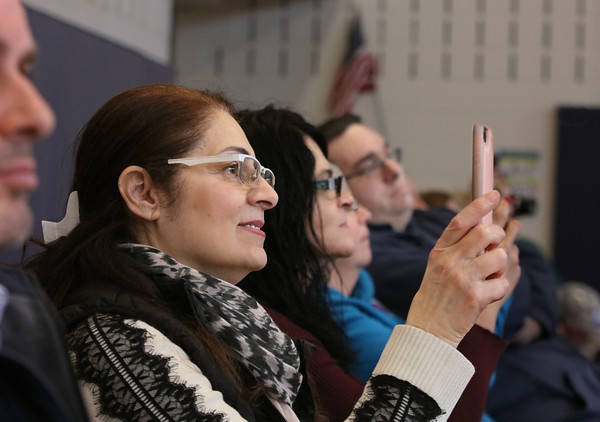 """MIKE SPRINGER/Staff photo<br /> Siham Yanchouchy uses her phone to photograph her granddaughter Chanelle Mazraany, who was playing the lead role of """"Anna"""" in the children's version of the Disney musical """"Frozen"""" on Thursday at Soule Elementary School in Salem. ore than 40 students from the 4th and 5th grades acted in the play, which was directed by Rebecca Pacuk..<br /> 2/20/2020 20017950A"""