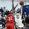 CARL RUSSO/Staff photo. Merrimack's Jaleel Lord sails to the basket against Sacred Heart's Tyle Thomas. Merrimack College defeated Sacred Heart 64-57 in men's basketball action. 2/21/2020