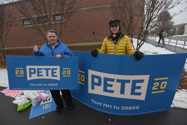 TIM JEAN/Staff photo <br /> <br /> Derry residents Owen Ingram, left, and Dylan Wetherbee held signs for presidential candidate Pete Buttigieg outside the Gilbert H. Hood Middle School during the New Hampshire primary.     2/11/20