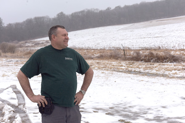 TIM JEAN/Staff photo <br /> <br /> Tyler Kimball, owner of Kimball Farm in Haverhill, looks out towards his sixty plus acres he farms. Kimbal has about a hundred acres of land.   2/7/20