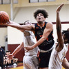 CARL RUSSO/Staff photo Greater Lawrence's Sam Cruz fights his way to the basket against Whittier's Anthony Couture, left and Yuki Efosa Aguebor.  Greater Lawrence Tech. defeated Whittier Tech. 53-42 in boys' basketball action. 2/03/2020