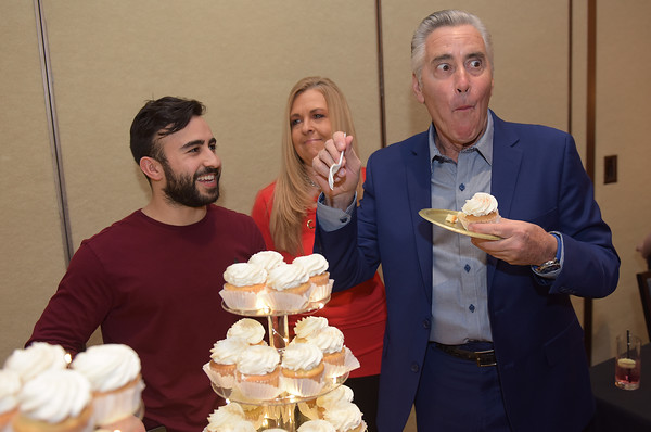 "TIM JEAN/Staff photo <br /> <br /> Host Billy Costa, right, from KISS108FM and ""Dining Playbook"" TV fame, reacts to the delicious cupcakes from Little Delights Bakery in Lowell, as owner Zack Smith, and his mother Robbin Smith look on during Congregation Beth Israel of Andover's annual Evening of Sweet Indulgence. The event featured some of the best desserts and appetizers from the Merrimack Valley's premiere restaurants and caterers. The was also live entertainment, raffles, and auction items. It was held in the in the Grand Ballroom at the DoubleTree by Hilton in Andover.       2/1/20"