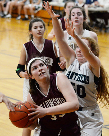 CARL RUSSO/Staff photo Fellowship's Ester Mills drives to the basket against PMA's Abigail Spaniol. Presentation of Mary Academy defeated Fellowship Christian Academy 51-43 in girls' basketball action Tuesday afternoon. 2/04/2020