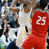 CARL RUSSO/Staff photo. Merrimack's Juvaris Hayes drives to the basket against Sacred Heart's Jare'l Spellman. Merrimack College defeated Sacred Heart 64-57 in men's basketball action. 2/21/2020