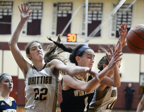 CARL RUSSO/Staff Photo Whittier's Rachel McGrath, left and Danielle Lear fight for the rebound with Winthrop's Maura Dorr. Winthrop defeated Whittier Tech. 55-39 in Div. 3 North quarterfinals in girls basketball action Thursday night. 2/27/2020