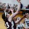 CARL RUSSO/Staff photo Fellowship's Ester Mills drives to the basket against PMA's Shannon Colleyer. Presentation of Mary Academy defeated Fellowship Christian Academy 51-43 in girls' basketball action Tuesday afternoon. 2/04/2020