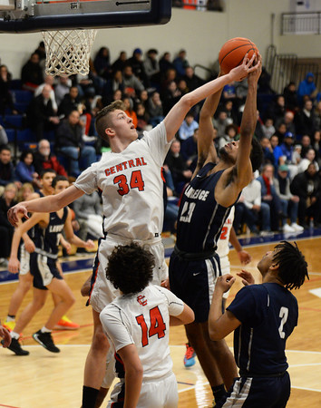 CARL RUSSO/Staff photo Central's captain, Anthony Traficante stops  Lawrence captain, Gabriel Zorrilla's drive to the basket. Central Catholic played against Lawrence in boys basketball action Tuesday night. 2/11/2020.